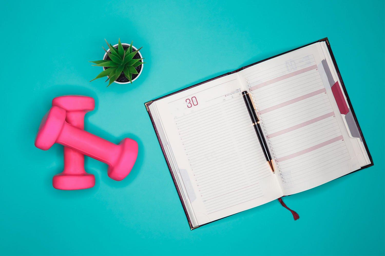 bigstock-Workout-Plan-In-Notebook-Flat-400726052