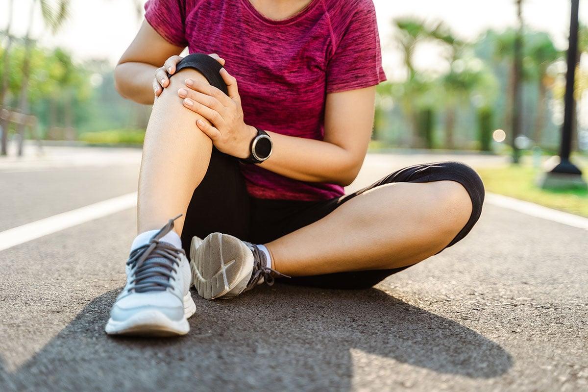 bigstock-Knee-Injuries-Sport-Woman-Wit-354877664